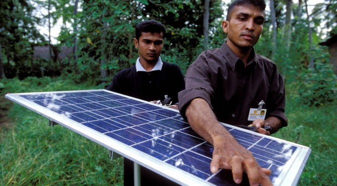 Two men with a solar panel